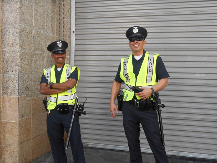 Sexy LAPD officers striking a pose on Hollywood Boulevard.