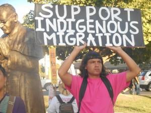Protestor seeking aid for immigrants in Los Angeles.